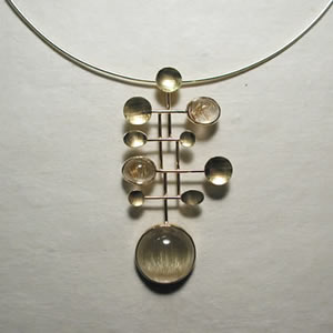 rutilated quartz molecular necklace 18k yellow gold